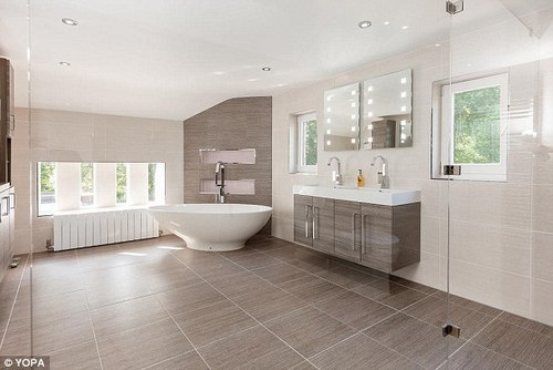 This spacious bathroom is in a five-bedroom detached house in Cheshire's Tarporley, which is on the market via estate agents Yopa for £1.6million