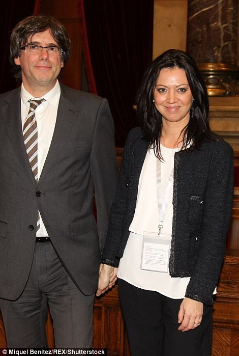 Pictured: Puigdemont and his wife Marcela