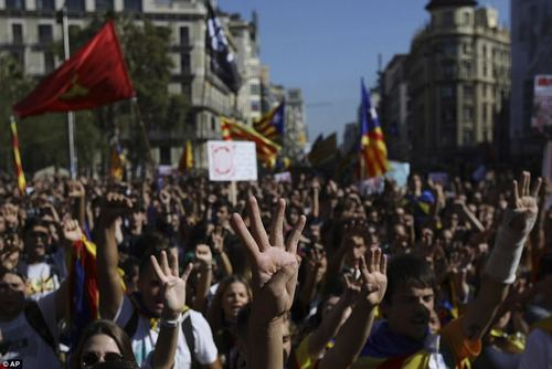 Hands up:Students gesture as they march during a protest against the Spanish government announcement of implementing the article 155 in Catalonia