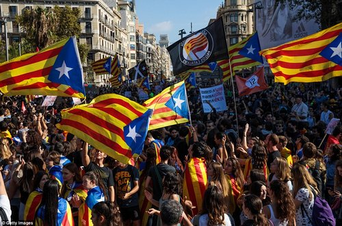 Tensions: University students caused chaos after calling a 'strike' to demonstrate the Spanish government's looming revoking of Catalan autonomy, but it saw lectures cancelled and others prevented from entering university grounds