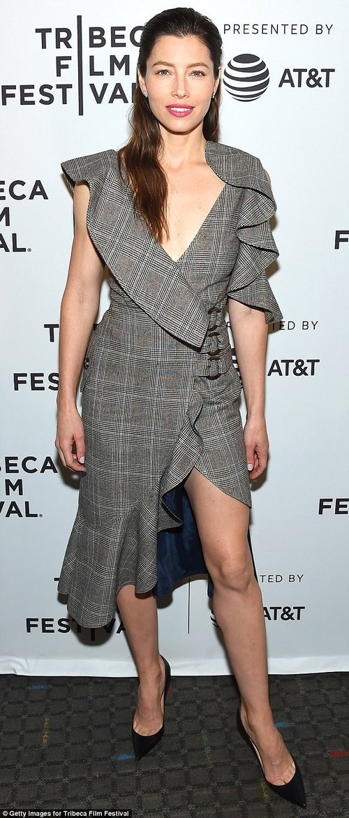 Previously on:That same dress, lined with ruffled at the top and cinched with three belts around the waist, was previously worn by Jessica Biel, who is also 35
