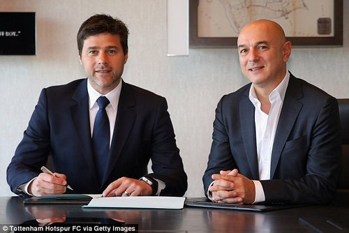 Pochettino pictured with Spurs chairman Daniel Levy when he signed a new contract in May