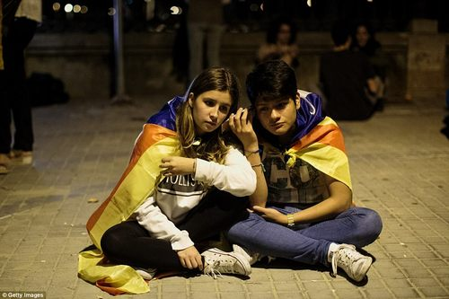 Supporters of independence gathered outside the parliament building where they listened to the debate on their phones