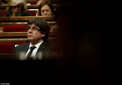 MrPuigdemont sat glumly as he listened to the debate, while outside supporters of independence branded him a 'traitor'