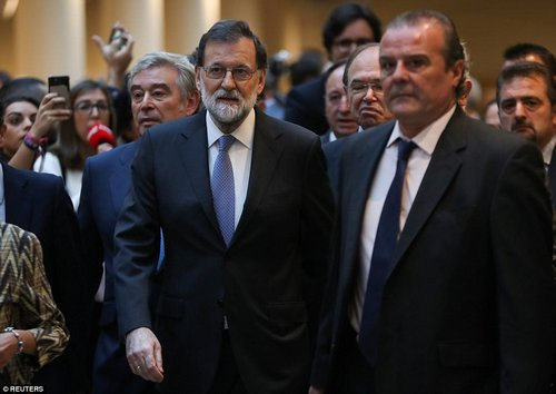 The senate, where Prime Minister Mariano Rajoy's Popular Party holds a majority, met to vote on steps to depose Catalonia's secessionist government before the week is out. Pictured: Spain's PM arriving in Parliament yesterday morning