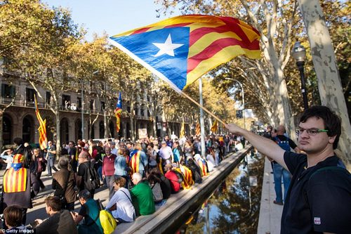 Catalan independence supporters gathered outside the Parliament of Catalonia ahead of the vote to call for independence from Spain - a demand they were soon granted
