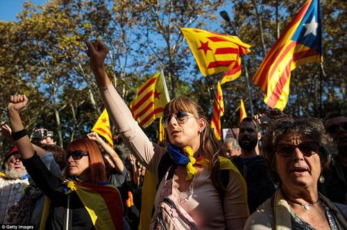 Pro-independence groups have vowed a campaign of civil disobedience to protect public buildings on the event of a crackdown by Madrid, which may involve the feared national riot police and even the army