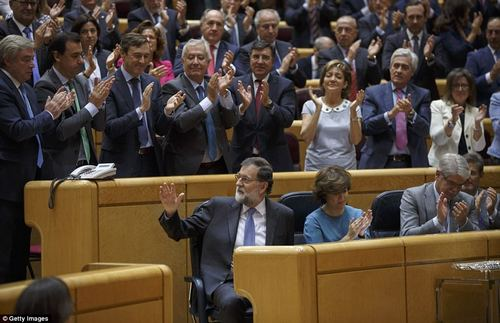 Speaking to the senate, Rajoy (pictured being applauded by lawmakers) said Spain had to force Catalonia to submit to the Spanish constitution.He also attacked the region for 'mocking democracy' in a way reminiscent of the era of fascist Spanish leader Francisco Franco, and said he wanted 'a return to legality'