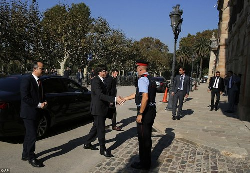 Legislators from both parliamentary groups in Catalonia have a slim majority which allowed them to pass the motion during a vote on Friday. Pictured: Puigdemont arriving at the parliament yesterday