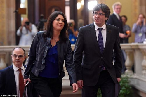 Catalan president Carles Puigdemont and his wife Marcela Topor arriving at the Catalan parliament in Barcelona yesterday