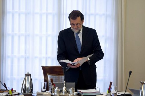 The Spanish prime minister - pictured at yesterday's cabinet meeting - wrote on Twitter immediately after the vote: 'I ask all Spaniards to remain calm. The rule of law will restore legality in Catalonia'