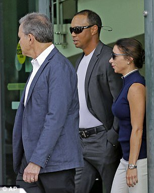 Woods arrives at the courthouse on Friday