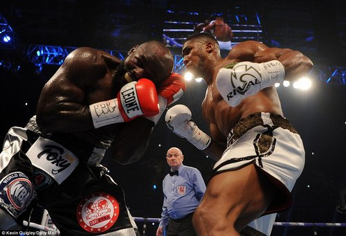 The Watford-born boxer unleashes a flurry of blows upon his opponents during the opening few rounds in Cardiff