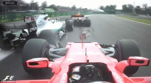 Vettel then drove into Hamilton's rear tyre, giving the German severe front wing damage and Hamilton a puncture
