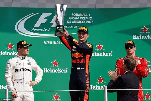 Verstappen claimed victory in Mexico from Mercedes' Valtteri Bottas (left) and Ferrari's Kimi Raikkonen