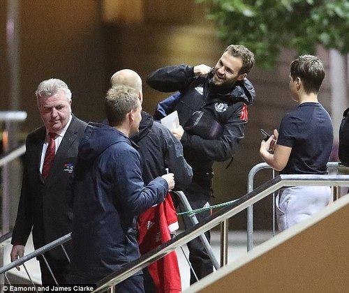 Juan Mata stopped to talk to United supporters and autograph hunters outside the hotel