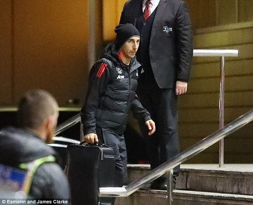 Henrikh Mkhitaryan hauls his luggage up the stairs outside the Manchester city centre hotel
