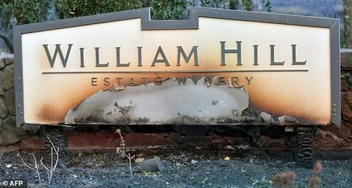 The William Hill Estate Winery sign is seen partially burnt in Napa, California