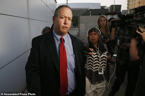 Attorney Brian T. Kelly answers questions as he leaves U.S. District Court with his client, founder of Insys Therapeutics John Kapoor, after Kapoor was arrested earlier Thursday, Oct. 26, 2017, in Phoenix. Kapoor and other defendants in the fraud and racketeering case are accused of offering bribes to doctors to write large numbers of prescriptions for a fentanyl-based pain medication meant only for cancer patients with severe pain. A judge set bail at $1 million for Kapoor, saying he must wear electronic monitoring and surrender his passports. (AP Photo/Ross D. Franklin)