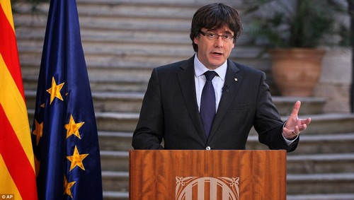 Catalan leader Carles Puigdemont gives a speech on national television yesterday afternoon. The politician urged citizens of Catalonia to 'peacefully resist' direct rule from the Spanish government