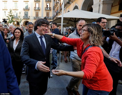 The sacked Catalan president hugs a supporter in Girona.The politician vowed to continue to 'work to build a free country' in his televised speech this afternoon