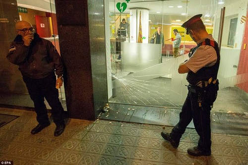 Violence flared on the streets of the Catalan capital on Friday night as furious unionists attacked Catalunya Radio, blaming journalists there for causing the independence declaration with their 'fake news'