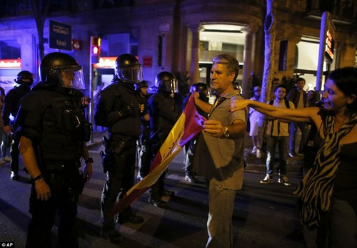 Among the thousands of people waving Catalan flags were a significant number of protesters with Spanish ones, including this man, pictured