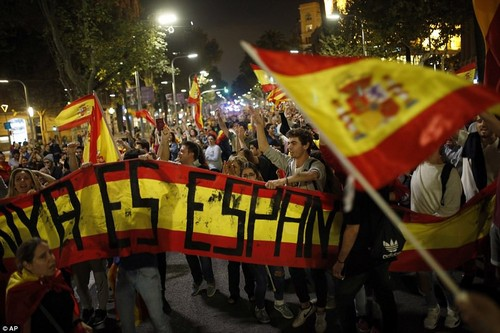 The declaration of independence was criticised by world leaders including Theresa May, who tonight said Britain 'will not recognise' Catalan independence as it was based on an 'illegal' vote. Pictured: Anti-independence protesters in Barcelona