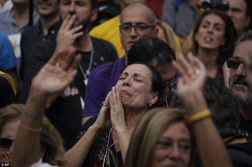 The independence motion was passed in the 135-strong assembly with 70 votes in favour, 10 against and 2 blank ballots, the assembly's speaker said. Pictured: A crowd in Barcelona reacts to the news yesterday