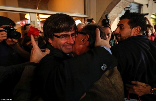 Sacked Catalan President Carles Puigdemont embraces a supporter during a walkabout the day after the Catalan regional parliament declared independence from Spain in Girona, Spain, on October 28
