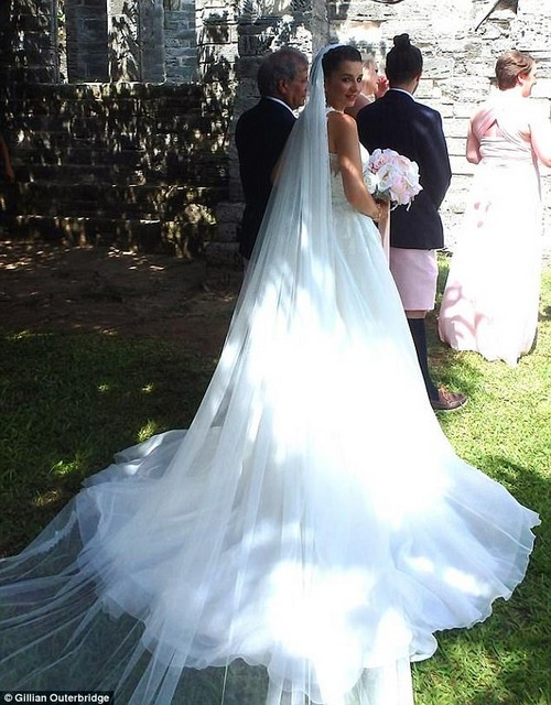 Miss Bento, who left Warwick Academy in 2009, has now tied the knot with her former drama teacherMatthew McGowan (pictured on her wedding day on July 21)