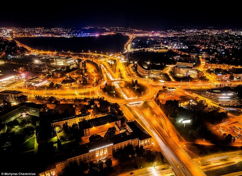 Neon nights: Illuminated by street lights and high-speed traffic, the nocturnal view of Vilnius oozes glamour