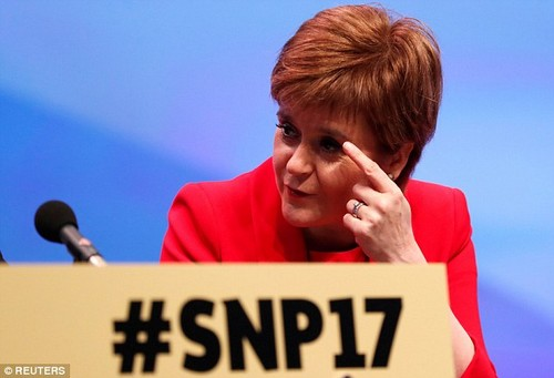 Nicola Sturgeon (pictured on stage during the second day of the SNP conference today) has claimed Ruth Davidson's Scottish Tories could block a hard Brexit