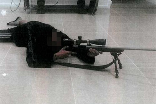 The 14-year-old boy posed as a sniper with rifles he took from his uncle's gun collection