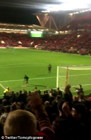 After Souare had given fans his shirt, the Palace fans showed their anger by launching it back