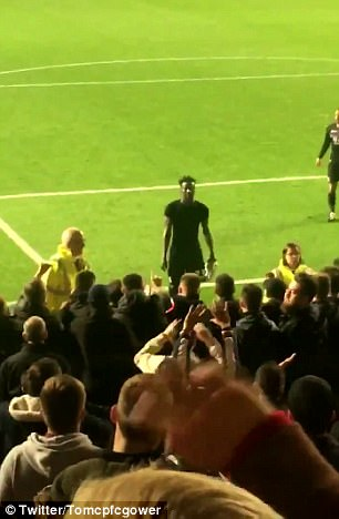 The left back went to confront the away supporters following humiliating 4-1 defeat in the cup