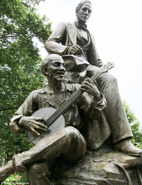 The statue is in a public park along a high-traffic portion of Forbes Avenue in Pittsburgh, Pennsylvania. Penn Live notes: 'The statue was designed to show Foster being inspired by a black musician, but the black man depicted in the sculpture, Uncle Ned, is a caricature popularized by minstrel shows'