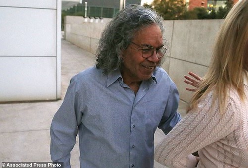 Billionaire founder of Insys Therapeutics John Kapoor leaves U.S. District Court after being arrested earlier Thursday, Oct. 26, 2017, in Phoenix. Kapoor and other defendants in the fraud and racketeering case are accused of offering bribes to doctors to write large numbers of prescriptions for a fentanyl-based pain medication meant only for cancer patients with severe pain. (AP Photo/Ross D. Franklin)