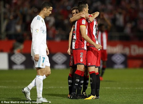 Cristiano Ronaldo cuts a defected figure as Girona players celebrate victory over Real Madrid