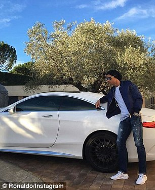 Ronaldo has one of the cars in black and another in white