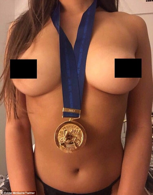 An image of a topless woman wearing a 2017 premiers medal belonging to an unknown player has been circulating on social media