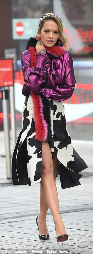 Mixing up her ensemble: The musician deliberately opted for a contrasting flashy blouse which featured ruffled cuffs
