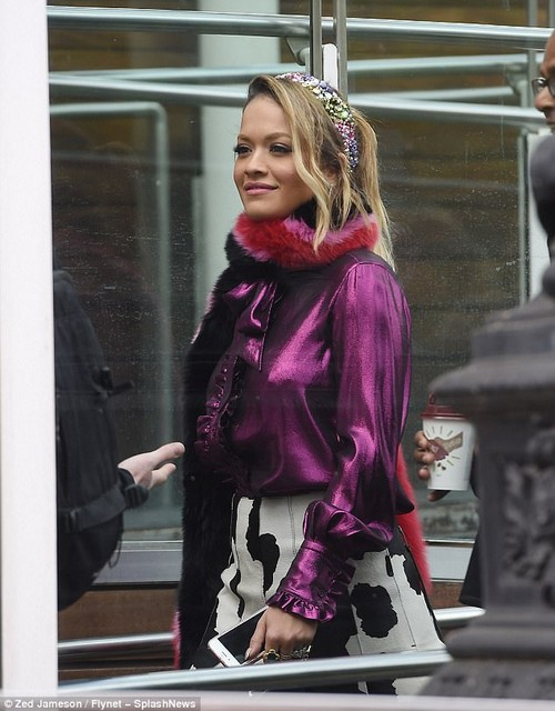 Jazzing up her look: The Your Song hitmaker injected sparkle into her attire with drop earrings as well as a vibrant headband which fitted like a tiara