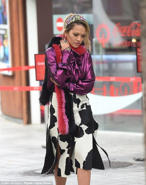 Trendsetter: The Hot Right Now hitmaker proved accessories make an outfit when she wrapped a pink, red and black fur scarf around her neck