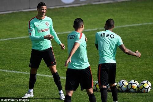 Despite this Ronaldo seems in confident mood as he laughs with team-mate Ricardo Quaresma