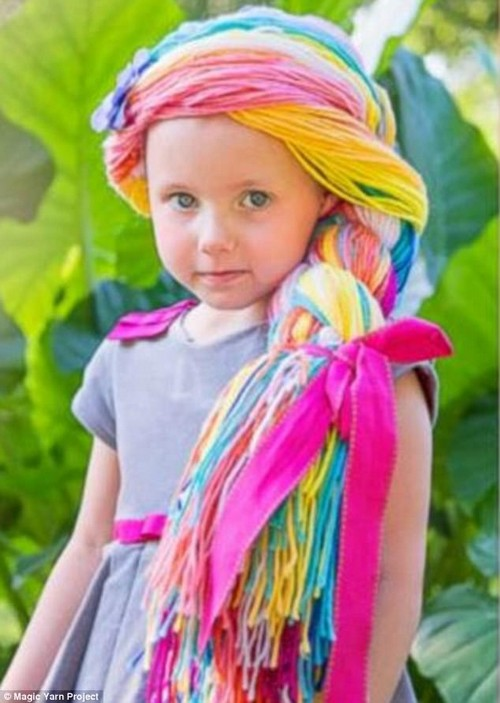 A royal look! A little girl dons her 'magic yarn wig' created by Magic Yarn Project, a nonprofit that crochets Disney character inspired wigs for child cancer patients