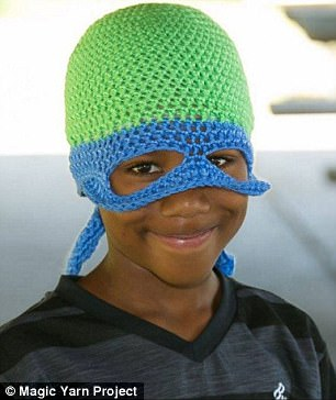 To the rescue! This little boy opted for a superhero crochet cap and mask for his yarn look