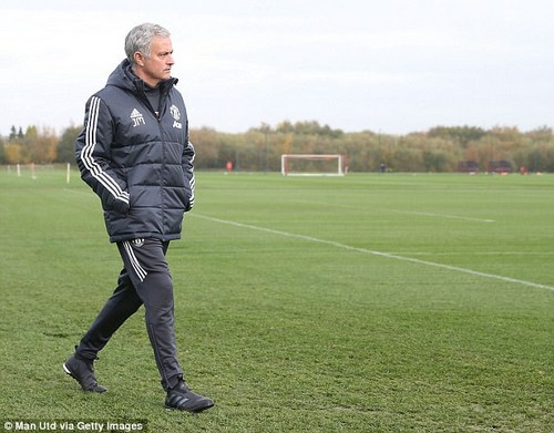 Manager Jose Mourinho watches on from the sidelines at Carrington during the session
