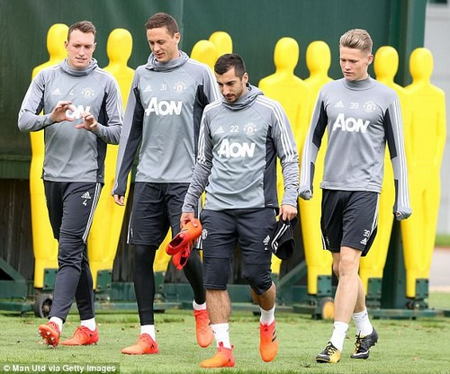 Phil Jones (left) has told Mourinho he is available for selection following last week's injury