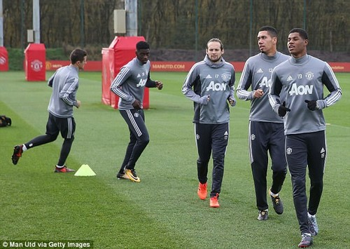Marcus Rashford (right) leads his team-mates as the United stars take part in training